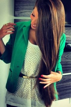 Long hair, green blazer, cinched waist