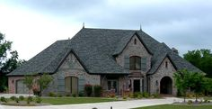 Rock and stone homes beautiful two story luxury brick for French country tudor house plans