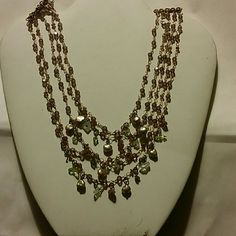 """Designer Necklace 5 strand Very pretty necklace. It has 5 layered strands on it. Gold colored with light amethyst, pestl, and lt. green colored stones. It has tag on it. Rachel Reinhardt New York. It is 18"""". Drapes nicely! Lightly used. rachel Reinhardt Jewelry Necklaces"""
