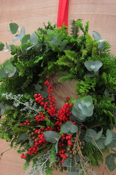 A burst of red winterberries. Fresh wreath from The Green Room.