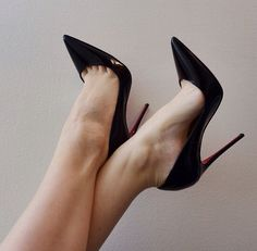 Black patent Louboutin pumps, arches, and toe cleavage!