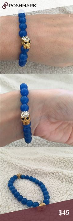 Gold skull blue stone bracelet Handmade blue natural stone gold skull bracelet! The bracelet has two gold skulls and is an amazing focal point on any wrist! Great gift for someone or yourself. Open to offers! Jewelry Bracelets