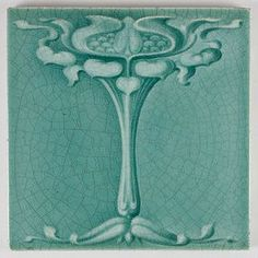 T & R Boote Art Nouveau majolica tile c. 1905.  Flower with heart shaped leaves.