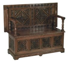"a good example of carved Jacobean furniture, this piece a folding ""monk's bench"":"