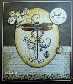 Awesome dragonfly stamp, I love the script paper and the earthy colors of the card.
