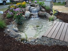 This is the Tranquility package pond by Living Waterscapes in Greensboro, NC.  A perfect backyard addition.