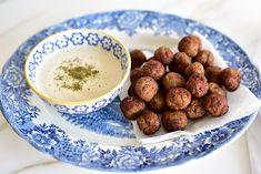 Kibbeh bites on a platter with tahini sauce, Maureen Abood