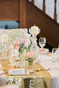 Glass vases and candlesticks are paired with soft baby's breath and pastel florals along with white table numbers and gold sequin table runners to create absolutely gorgeous tablescapes. See more from this Dreamy Pink and Gold Outdoor Real Wedding here: http://blog.myweddingreceptionideas.com/2017/04/dreamy-pink-and-gold-outdoor-real.html