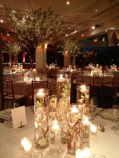 Cylinder vases with floating Candle Centerpiece and Submerged Babys breath / Curly Willow