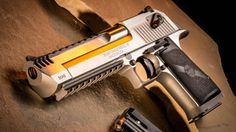 """The Magnum Research Stainless Desert Eagle """"When you have to takedown a tree and don't have an ax, Poof DONE!"""""""