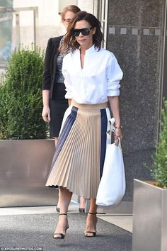 Victoria Beckham wearing Manolo Blahnik Chaos Sandals in Black, Victoria Beckham D-Frame Acetate Sunglasses and Victoria Beckham Spring 2017 Skirt