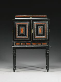 A Flemish ivory inlaid ebony, ebonised and tortoiseshell cabinet inset with painted panels, in the manner of Hendrik van Balen (1575-1632), Antwerp second half 17th century - Sotheby's