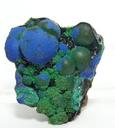 Indigo Blue Azurite on Malachite Mineral by FenderMinerals on Etsy,  Morenci Copper Mine, Morenci, Arizona Bright lighting really makes the azurite pop, so pic 3 shows the specimen in dim lighting 26.5 grams 1.2 inches x 1.2 inches x .75 inches thick by echkbet