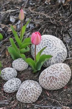 Doily-covered garden rocks