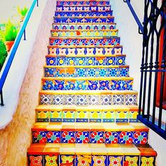 mosaic staircase. How wonderfully cheerful! Couldn't you just imagine that staircase greeting you everyday?
