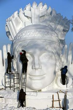 Workers carve a large snow sculpture at the Sun Island Park during the 26th China Harbin International Snow Sculpture Art Expo in Harbin, He...