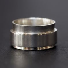 Sterling silver spinner ring for men and women, handmade by Rebecca Cordingley