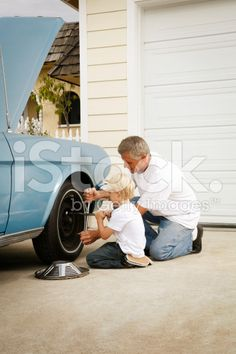 Father and Son Working on the Car royalty-free stock photo