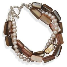 8 Inch Multi-strand Shell and Cultured Freshwater Pearl Fashion Toggle Bracelet West Coast Jewelry. $29.95