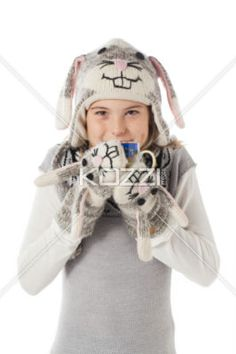 image of a teenage girl wearing a rabbit costume while holding a coffee cup. - Portrait image of a teenage girl wearing a rabbit costume while holding a coffee cup. Model: Shania Chapman - Agent is Breann at MMG. breann@nymmg.com