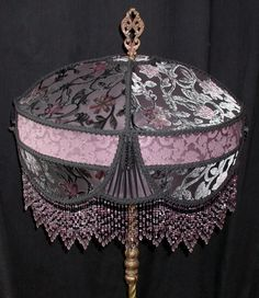 vintage style black trim and the six-inch amethyst and gray beaded fringe complete the lampshade.The vintage style black trim and the six-inch amethyst and gray beaded fringe complete the lampshade.