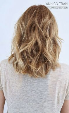Layered Wavy Hairstyle for Medium Hair