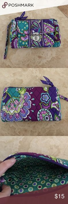 """Vera Bradley Heather pushlock Wristlet smartphone Vera Bradley Heather print Pushlock Style Wristlet . Features from pocket with push down lock , zipper closure , interior zipper pocket and 4 slots for Credit cards and license . Padded and can hold smartphone easily . I have a IPhone 6sPlus plenty of space for it with room . Measures 8""""x5""""X1.5"""" Carried 2-3 times in very good condition no stains or holes . Smoke/pet free home . I have more pieces in this collection make me an offer I love😍…"""