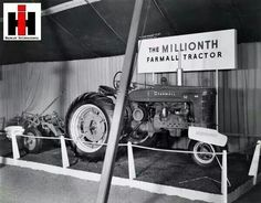 """The one millionth Farmall tractor on display, likely at International Harvester's Years in Chicago"""" celebration. A sign reads: """"The Millionth FARMALL. Antique Tractors, Vintage Tractors, Vintage Farm, International Tractors, International Harvester, Farmall Tractors, John Deere Tractors, Tractor Pictures, Red Tractor"""