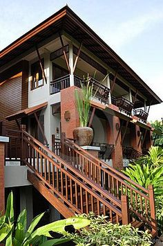 Photo about Modern design for this Thai house surrounded by vegetation. Image of modern, house, staircase - 13807081 Style Tropical, Modern Tropical House, Tropical House Design, Tropical Houses, Thai House, Asian House, Filipino Architecture, Tropical Architecture, Spanish Architecture