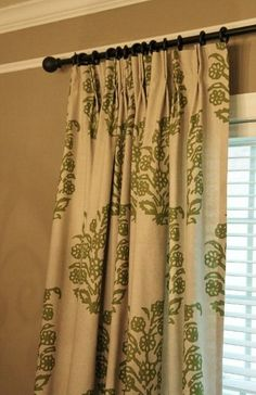 How to add pinch pleats to store bought rod-pocket drapes.  Looks easy with some help from mom:)