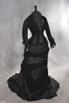 1878. The year I have the figure for!  Not too tight of a corset, and small bustle.