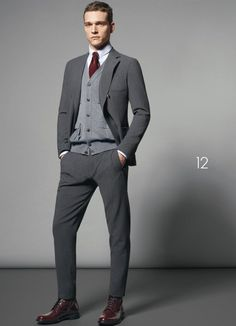 Pairing a grey wool suit and a grey cardigan will create a powerful and confident silhouette. A pair of burgundy leather dress boots will seamlessly integrate within a variety of outfits. Shop this look on Lookastic: https://lookastic.com/men/looks/suit-cardigan-dress-shirt/15722 — White Dress Shirt — Burgundy Tie — Grey Cardigan — Grey Wool Suit — Burgundy Leather Dress Boots