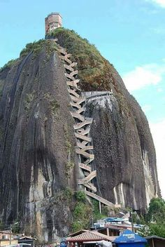 I wonder where is this place.  Cool staircase up to the peak.