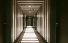 berlin 2011 - precious - glamorous - luxurious - vintage - black - white - classic - corridor - stripes - straight ahead - hotel - schwarz weiß - flur - streifen