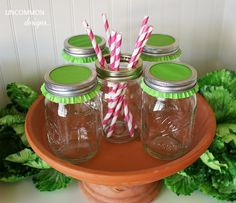 Great idea!  Use a cupcake liner with your mason jar lid rim and serve drinks with straws --- poke the straw through the cupcake liner and sip away!  Keeps bugs out and looks so adorable!