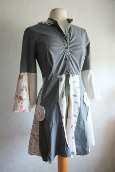 like the mixed patterns and the sleeves---upcycled shirt -interesting idea...