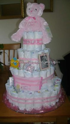 Pink Bear Diaper Cake... This website is the Pinterest of diaper cake ideas