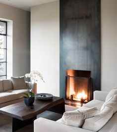 stainless steel fireplace wall - canadian house and home magazine Slate Fireplace Surround, Metal Fireplace, Modern Fireplace, Fireplace Mantle, Fireplace Surrounds, Fireplace Design, Living Room Remodel, Elegant Homes, Living Spaces