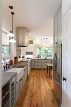 Beautiful kitchen.. love the pine floors and green cabinetry