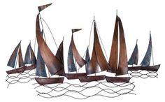 Metal art sailboats on waves