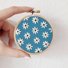 This little cutie is hanging out in my shop waiting for it's forever home. 💙 Several other one of a kind pieces also available! Link in… Embroidery Hoop Art, Floral Embroidery, Embroidery Patterns, Honey Logo, Teal Fabric, Cross Stitch Flowers, Pretty Art, Embroidered Flowers, Cross Stitching