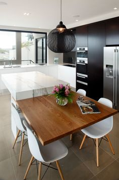 Cantilevered bench + design of an informal table adjoining the kitchen island...love it!