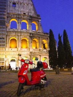 With Vespa in Rome, Italy
