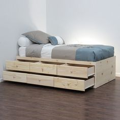 Twin storage or captain beds, without headboards or footboards, turned sideways and fixed against a wall can also pose as daybeds.