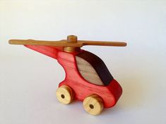 Handmade wooden Helicopter. Wooden toy, Non toxic finish. This colourful and tactile toy will give your child hours of fun. Dimensions: Helicopter body 215mm(L) 65mm(W) 120mm(H) 205mm Across rotor. Note: This toy is not suitable for children under 3 years old.