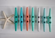 Colorful Boat Cleat Wall Hook - I WOULD LIKE TO USE THESE AS CURTAIN TIEBACKS IN MY BEACH THEMED MASTER BEDROOM.