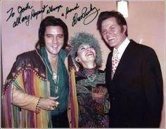 Elvis with Hawaii 5-O star, Jack Lord and his wife. Elvis gave Jack Lord a beautiful gun.
