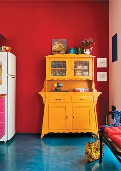 I think I'll do my dining room sideboard in a similar bright rich yellow ~ like BM yellow rain coat or yellow marigold. Will look great against the BM Caliente red walls