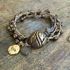 This boho chic multi wrap features beautiful Picasso Czech beads crocheted with sand colored nylon cord; the contrast is gorgeous! The strand