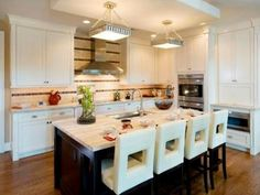 """There is task lighting, cabinet lighting and smart systems that are programmed for entertaining, cooking or homework time. Lighting draws the eye to interesting surfaces and improves the overall functionality of a kitchen. """"The lighting is what makes a kitchen — it creates a feel and an aura for the space,"""" says Daniel Steinkoler, Superior Home Services Inc., Washington, D.C. Design by Lisa Stanley"""